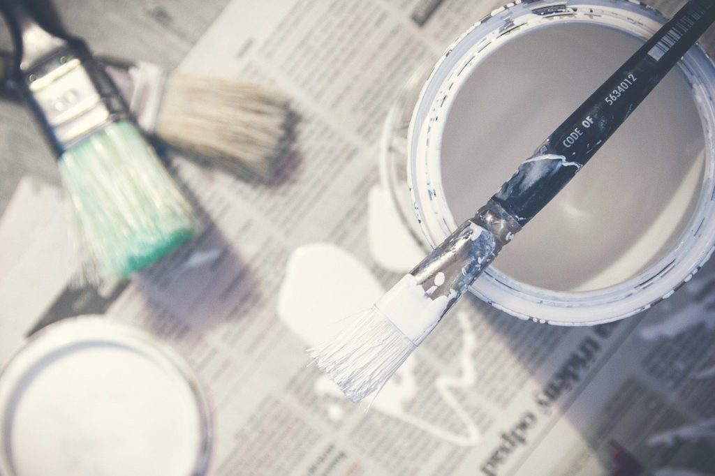 paint, brushes, bucket